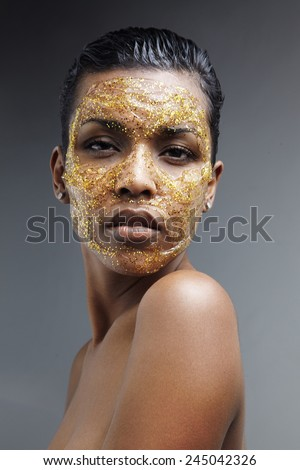 black woman with a golden mask