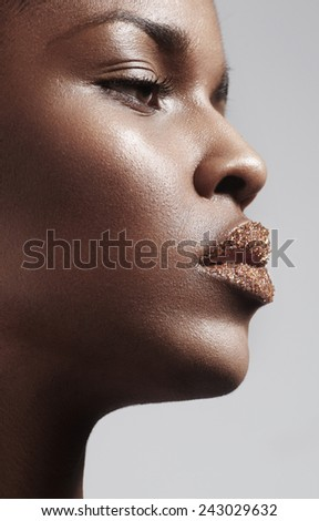 Black woman with a sugar lips - stock photo