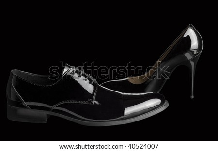 black women's and men's shoes on black - stock photo