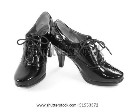 Black women's patent leather shoes isolated on white background