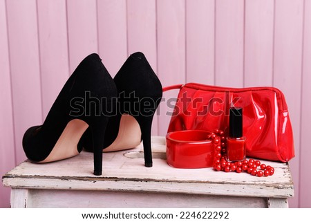 Black women shoes and beautician on wooden background - stock photo
