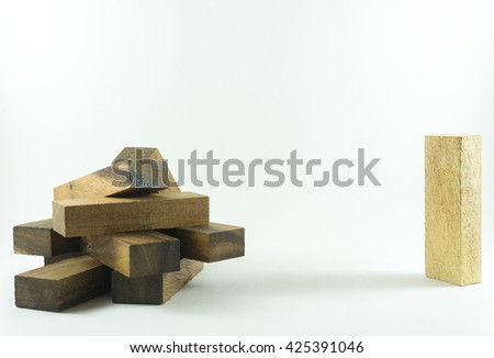 Black wooden block stacking as step stair on the left . Single white wooden block on the right side. On white backgroud. Think differenct concept for growth success process. - stock photo