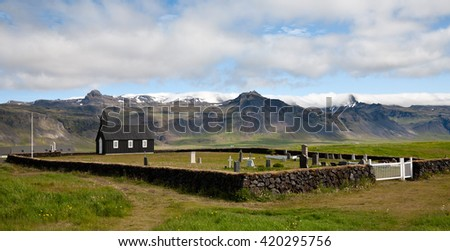 Black wooden church and small cemetery in Budir, Snaefellsnes peninsula, Western Iceland - stock photo