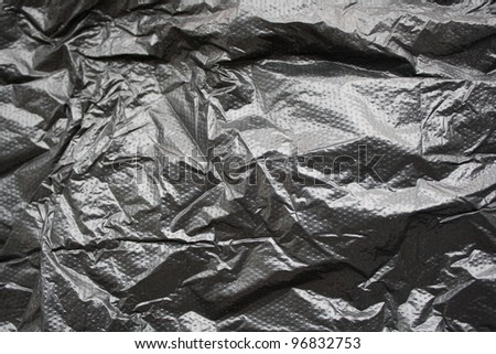 black wrinkled plastic bag for background - stock photo