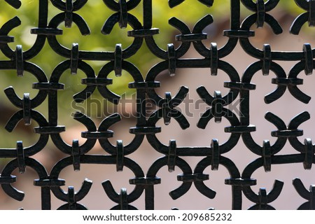 Black Wrought Iron Fence / Silhouette of an old wrought iron fence painted with black color - stock photo