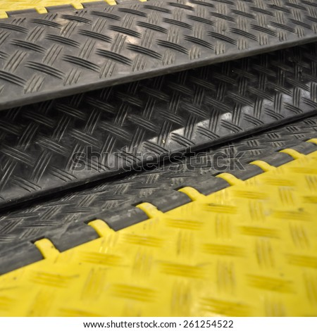 black-yellow speed bumps Humps - stock photo