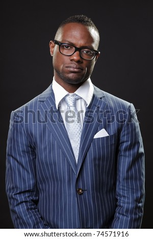 Black young business man in suit with glasses looking serious. - stock photo