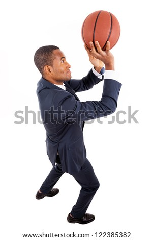 Black young business man playing basketball, isolated on white - stock photo