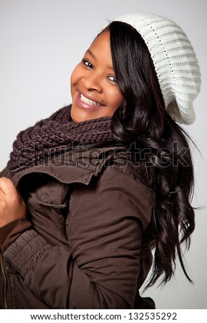 Black Young Woman Smiling with Winter Wear - stock photo