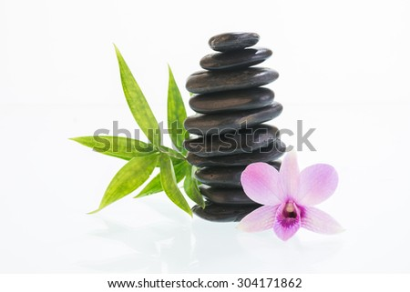 Black zen stones with Dendrobium orchid close up - stock photo