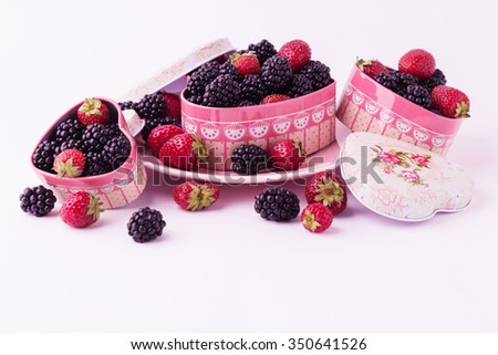 Blackberries and strawberries for Valentine's Day. Isolated background. Selective focus. - stock photo
