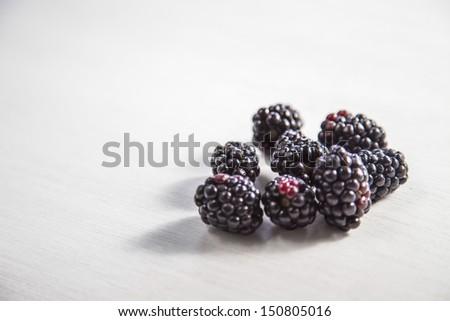 Blackberries on the white wood background - stock photo