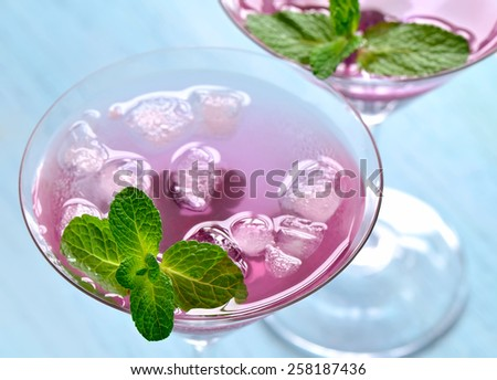 Blackberry and mint summer cooler or maybe alcoholic cocktail, selective focus - stock photo