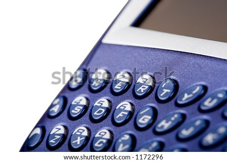 Blackberry cell phone keyboard close-up. Shallow depth of field. Isolated on white. - stock photo