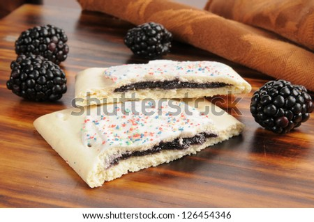 Blackberry filled toaster pastries with frosting - stock photo