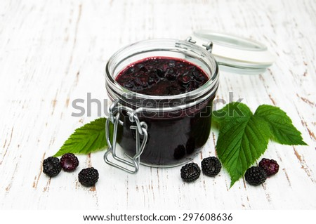 Blackberry jam and fresh blackberries on a wooden background - stock photo