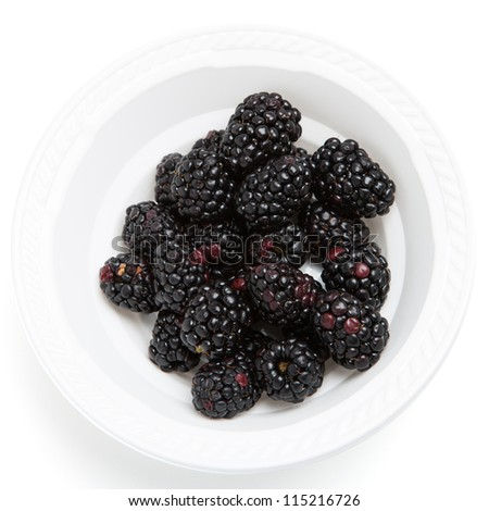 Blackberry on a white plastic plate