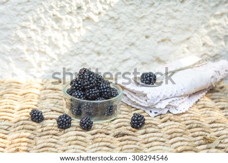 Blackberry on wicker background and vintage spoon. With space for text.  - stock photo