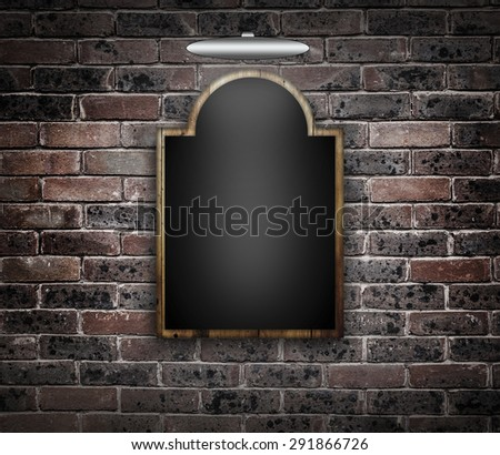 Blackboard against a brick wall. - stock photo