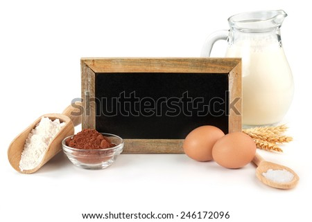 blackboard and ingredients of chocolate cake on white background - stock photo