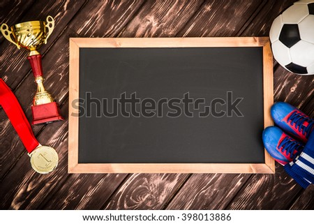 Blackboard blank with copy space for soccer game strategy. Ball, trophy and medal - stock photo