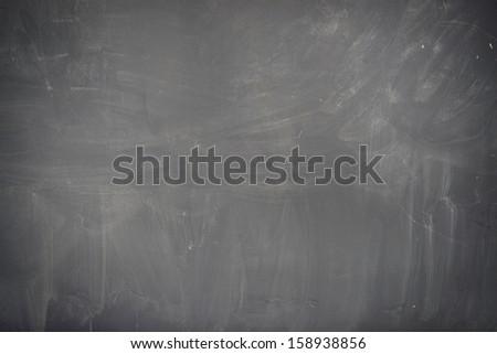 Blackboard ( chalkboard ) texture. Empty blank black chalkboard with chalk traces  - stock photo
