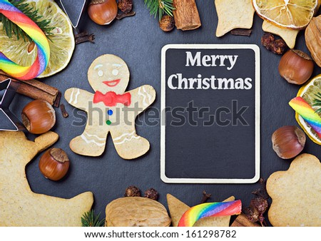 blackboard for writing greetings and ingredients for cooking and baking Christmas cookies - stock photo
