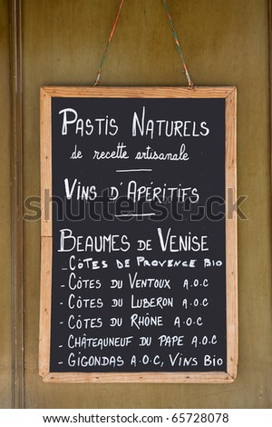 Blackboard in France with written the prices of bottles with wine