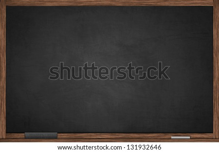 Blackboard in wooden frame with chalk and eraser - stock photo