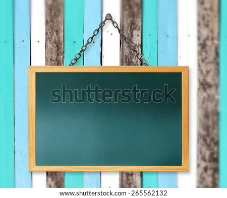 Blackboard on a wooden background - stock photo