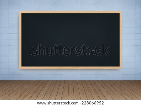 Blackboard on white concrete wall background and wooden floor.