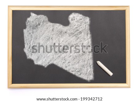 Blackboard with a chalk and the shape of Libya drawn onto. (series) - stock photo