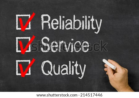 Blackboard with a checklist Reliability, Service and Quality - stock photo