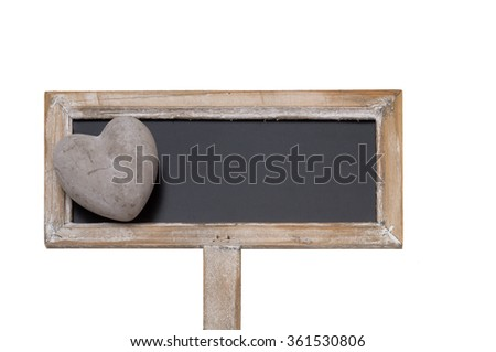 Blackboard with a heart made of stone isolated in front of a white background