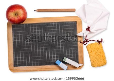 Blackboard with apple, sponge, chalk, cloth and pencil - stock photo