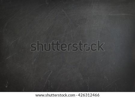 Blackboard with chalk marks on a blackboard. - stock photo