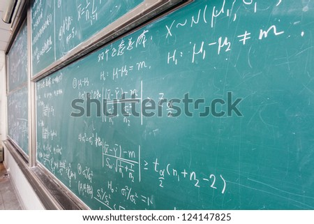 blackboard with complicated math formulas