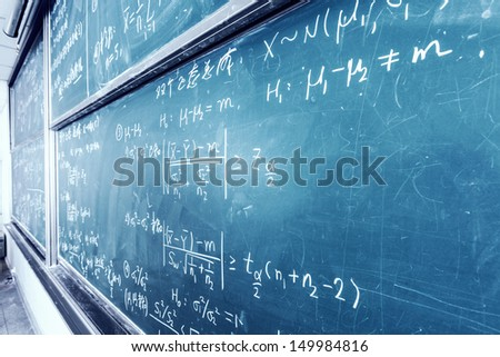 blackboard with complicated stastical math formulas - stock photo