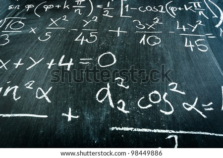 Blackboard with formulas and numbers - stock photo