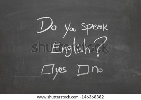Blackboard with the text - Do You Speak English? - stock photo