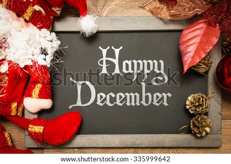 Blackboard with the text: Happy December in a christmas conceptual image - stock photo