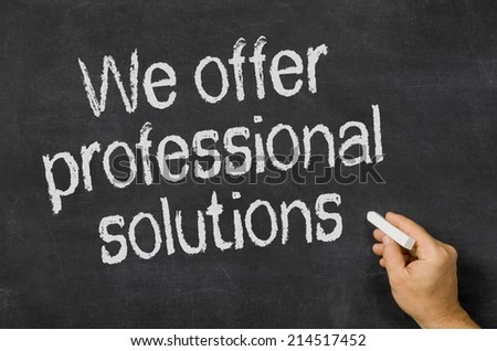 Blackboard with the text We offer professional solutions - stock photo