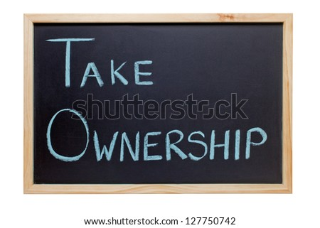 Blackboard with the words Take Ownership - ideal for presentations and training. - stock photo