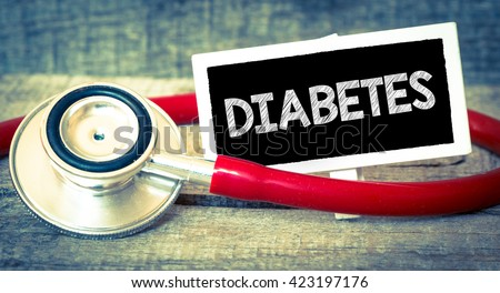 Blackboard with word diabetes and stethoscope. Medicine concept. Blackboard with word diabetes and stethoscope