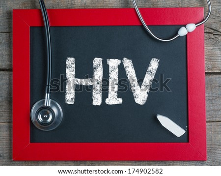 Blackboard with word HIV and stethoscope, medecine concept  - stock photo