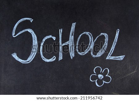 Blackboard with written school and flowers