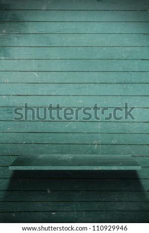 Blackboard wood shelf, grunge industrial interior Uneven diffuse lighting version - stock photo