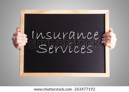 blackboard write Insurance Services - stock photo