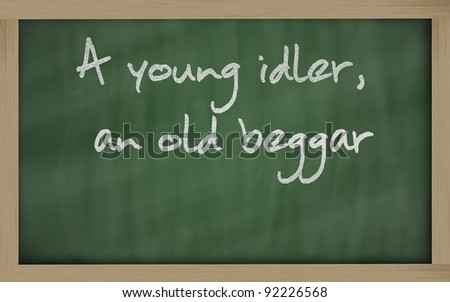 "Blackboard writings "" A young idler, an old beggar "" - stock photo"