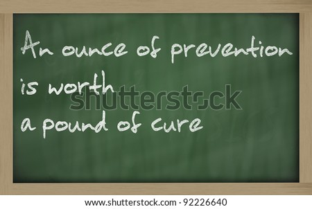 """Blackboard writings """" An ounce of prevention is worth a pound of cure """" - stock photo"""